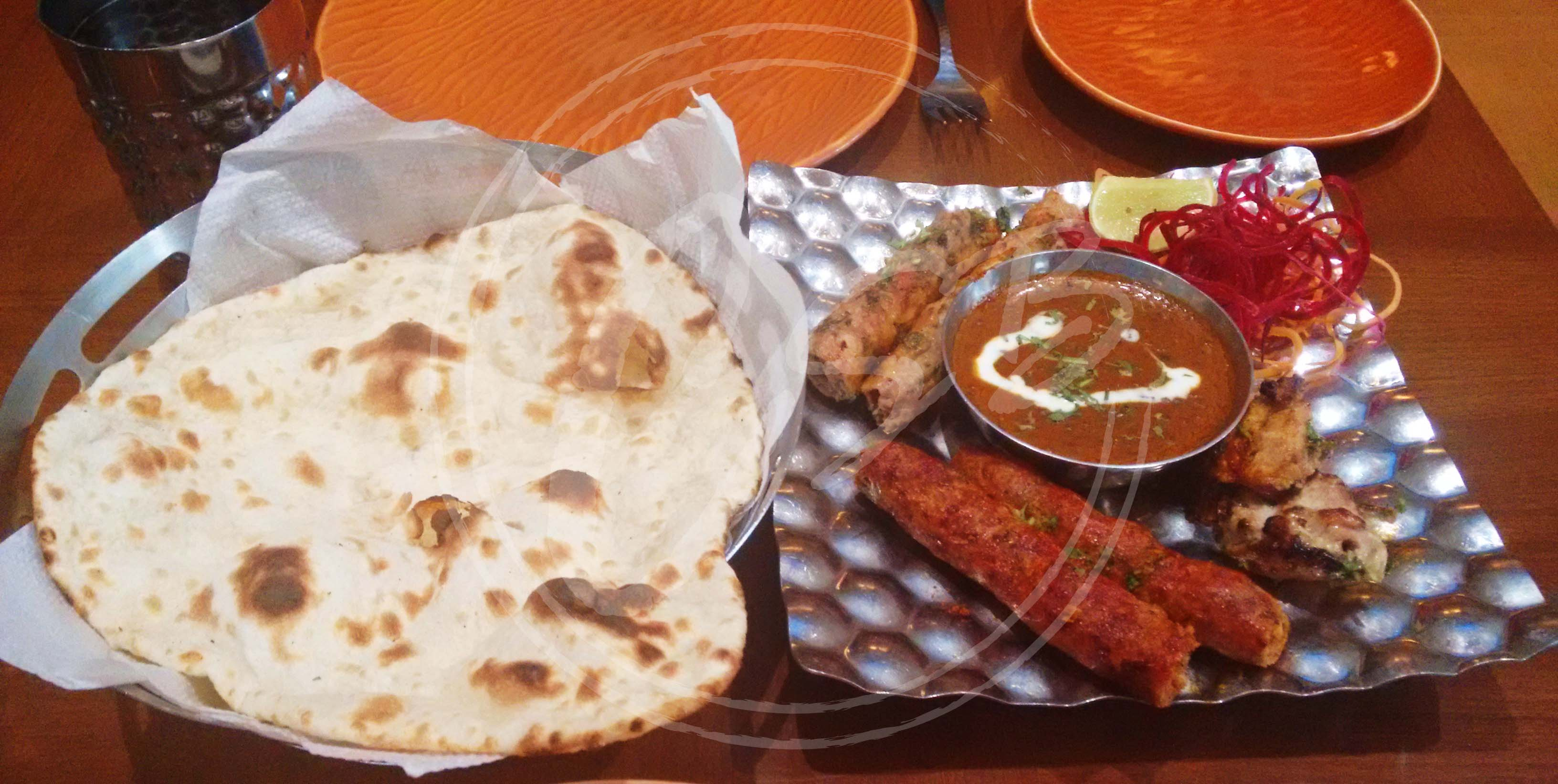 The kebab platter at Punjabi by nature quickie with peshawari kebab, chicken seekh kebab and reshmi seekh kebab complete with a bowl of creamy dal makhni and naan.