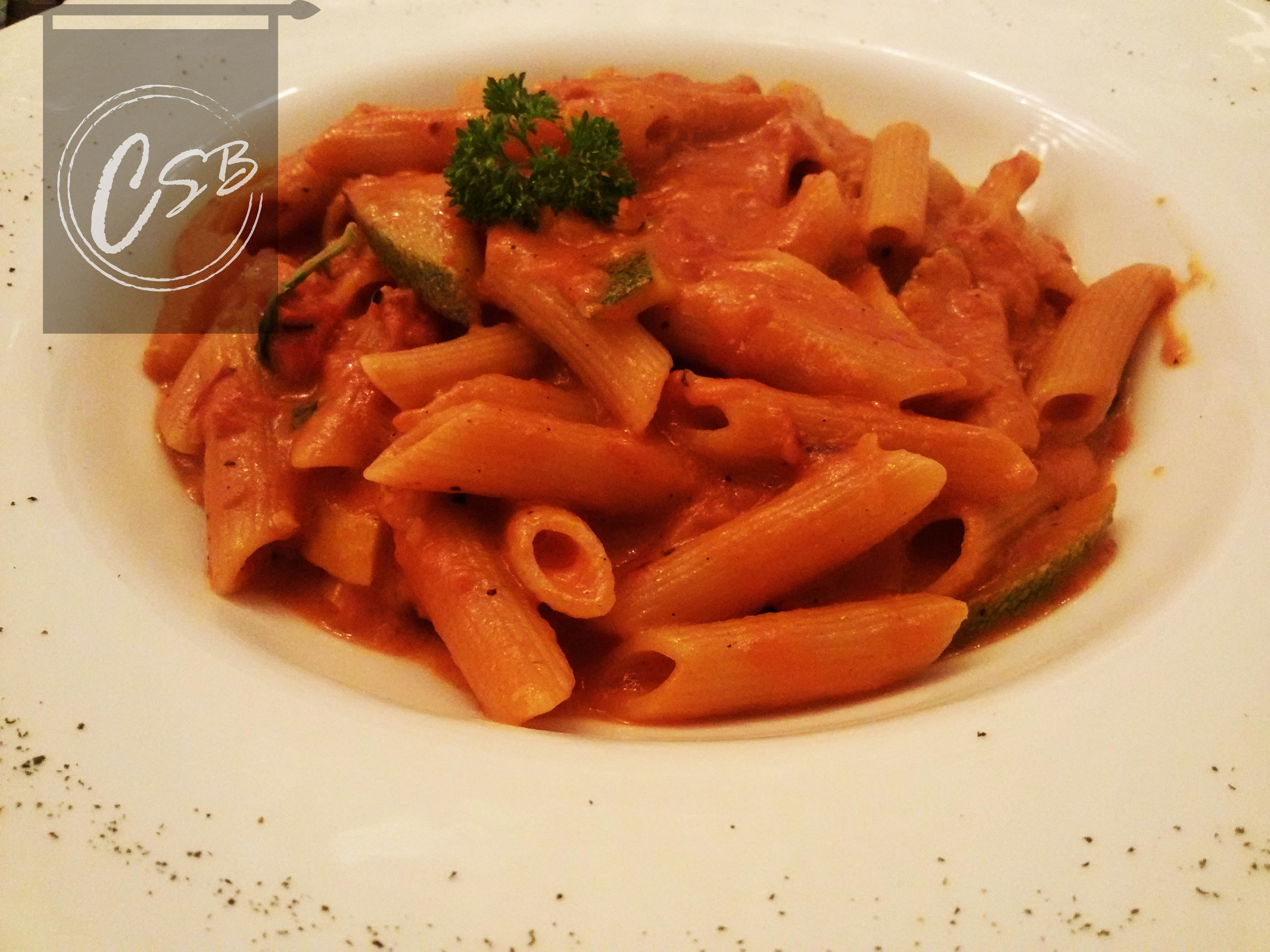 Penne with curried market vegetables in pink sauce