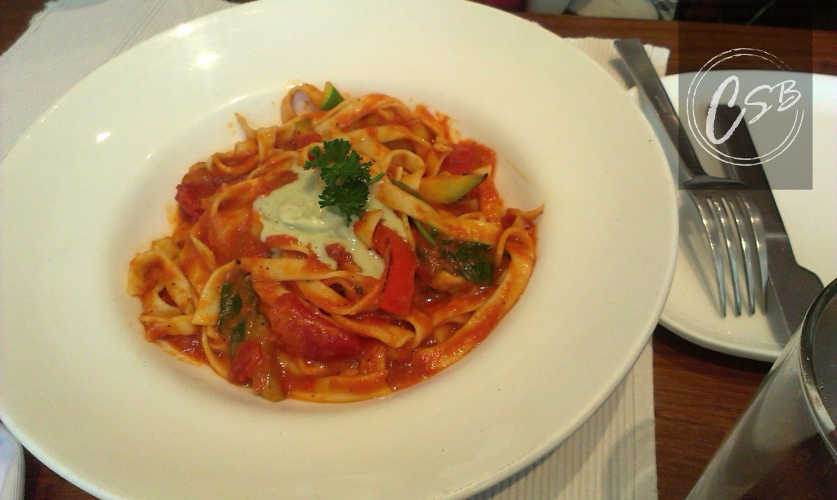 roast garlic and plum tomato fettucine