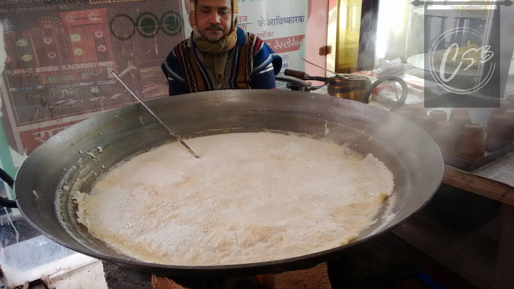 Flavoured milk being thickened and served malai maarke.
