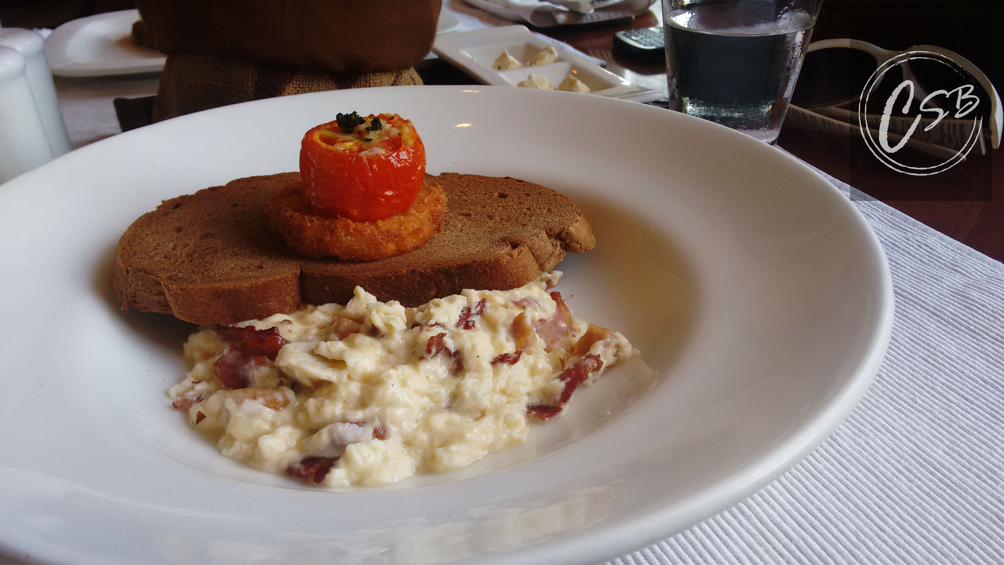 Terracotta scrambled eggs with sausage and bacon