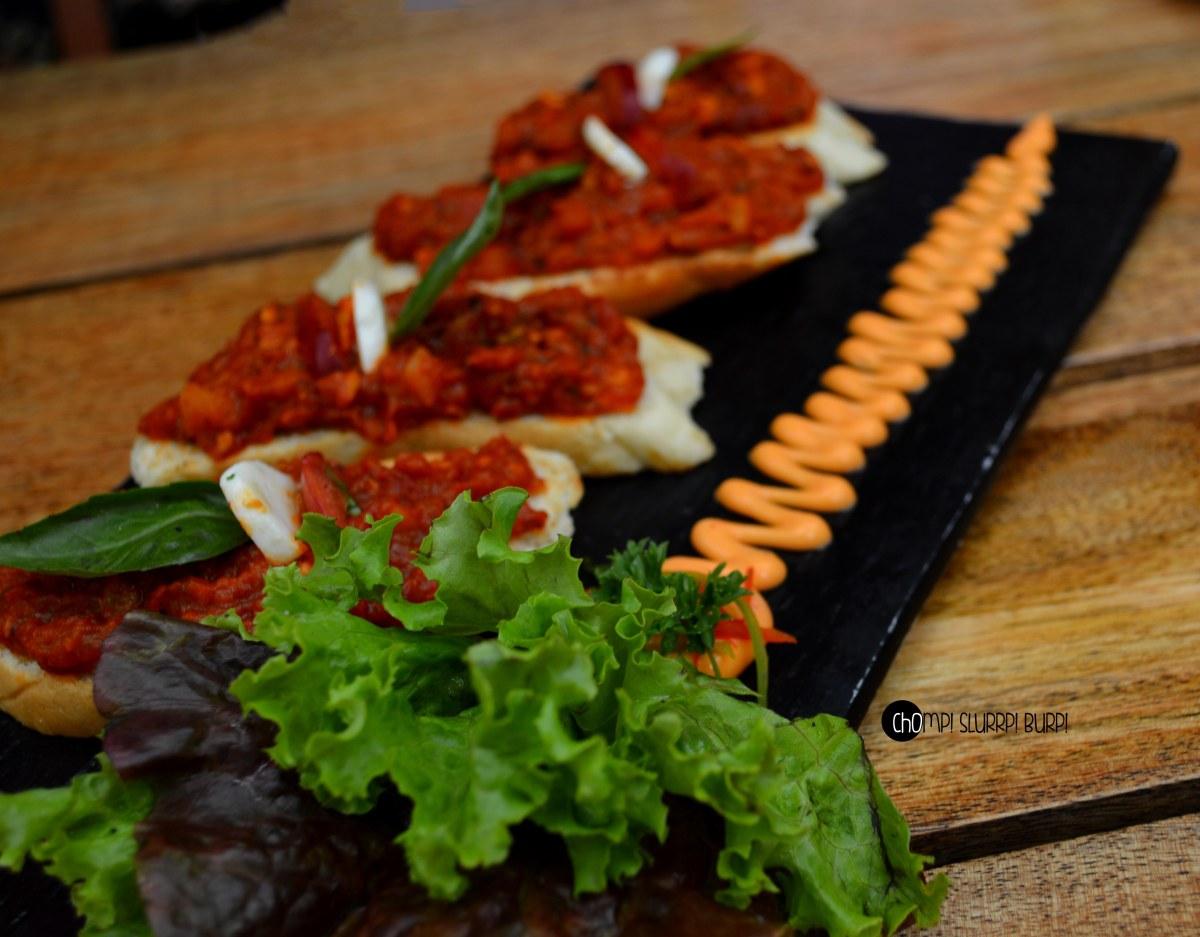 cheese and plum tomato sauce crostini