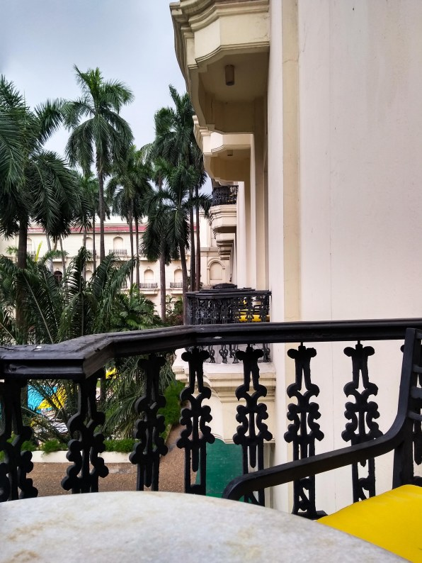 Balcony, palm trees and hints of yellow